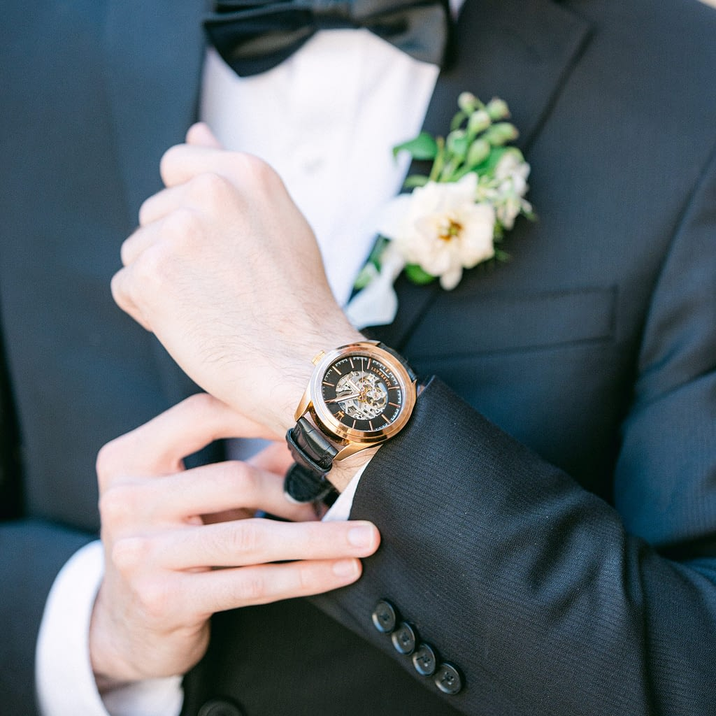 A groom showing off his beautiful family heirloom watch by Amy Huang Photography a Wedding Photographer in San Diego