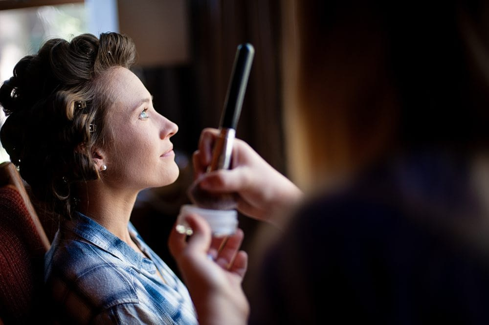 Beautiful Window Light falling on Bride during makeup during Kayla and Jackson's Rustic Mammoth Lake Wedding, Photo taken by Amy Huang Photography