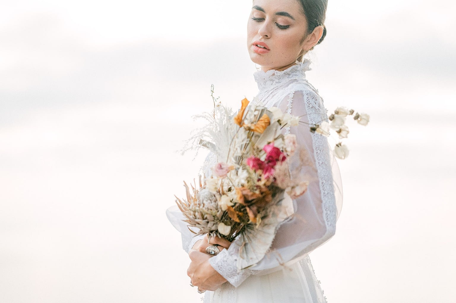 beautiful bride in a antique dress and a dry bouquet by Amy Huang Photography, a San Diego Photographer styled by wedding stylist Angel Tan