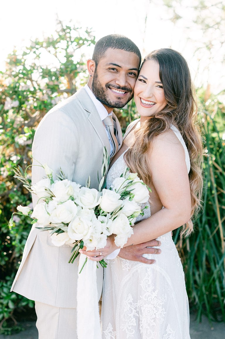 Newlywed smiling with joy at the camera | photo by Amy Huang Photography a San Diego Wedding Photographer