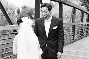 groom looking at his beautiful bride for the first time - with a face that is unforgettable a photo by Amy Huang Photographer a San Diego Wedding Photographer
