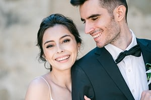 Bride smiling at the camera with groom looking at the bride by Amy Huang Photography a San Diego Wedding Photographer