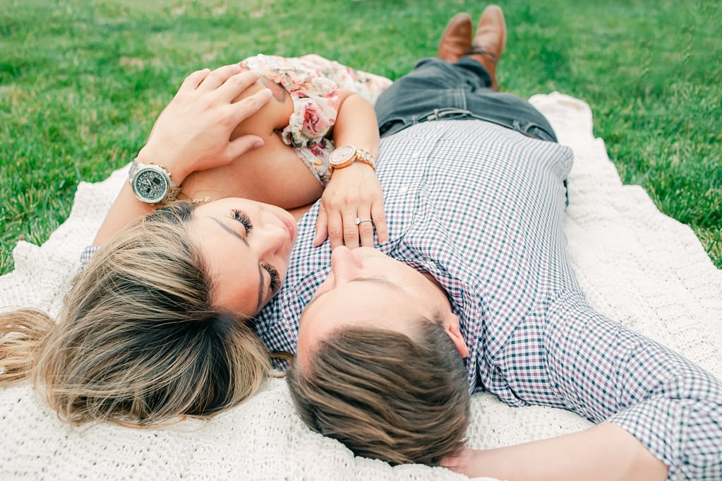 Couple lying on a blanket on the grass enjoying each others company at Vitagliano Winery in Temecula, Photo taken by Amy Huang Photography