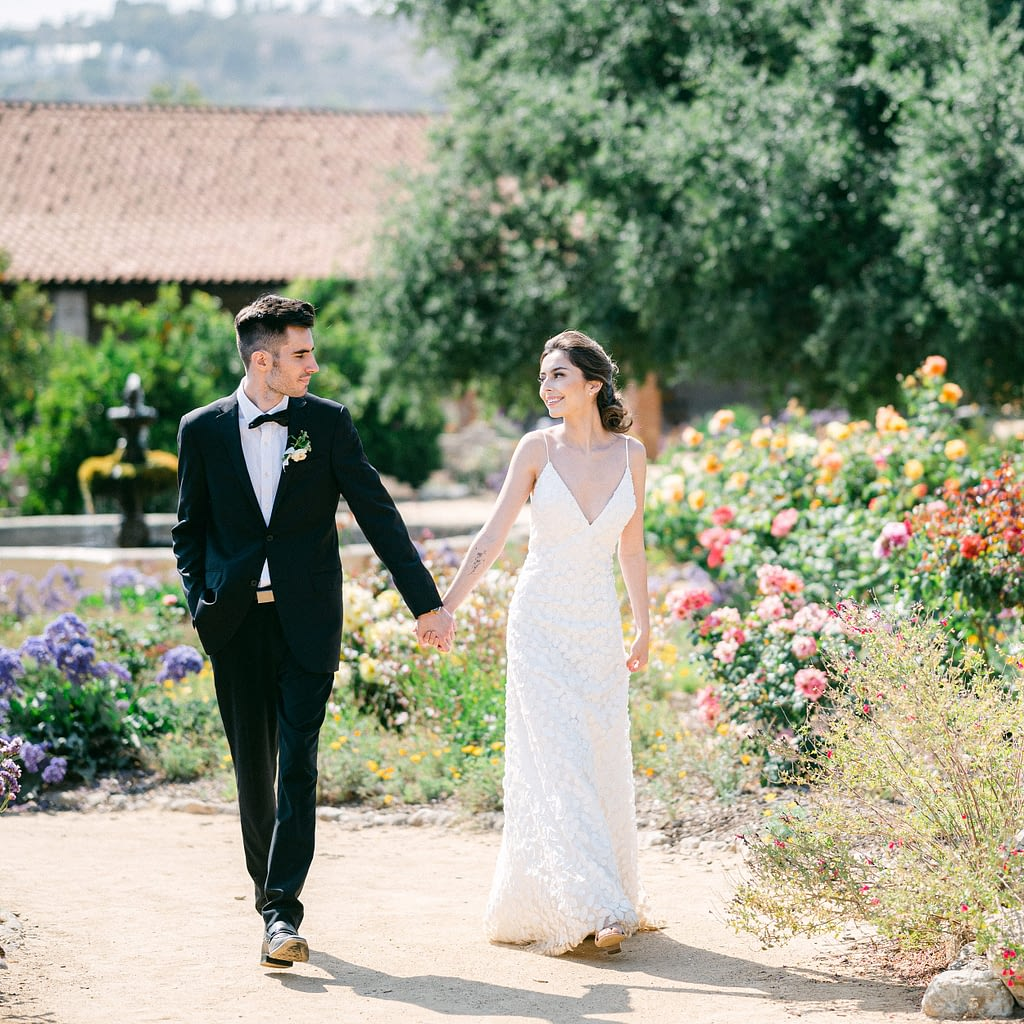 Bride and groom walking in a beautiful garden by Amy Huang Photography a Wedding Photographer in San Diego