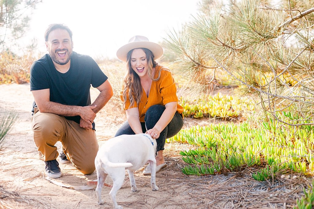 Couple with their dog, smiling and having a beautiful time by Amy Huang Photography