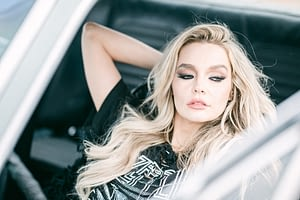 Beautiful model in an antique car looking outside the door, by Amy Huang Photography a San Diego Fashion Photogrpaher