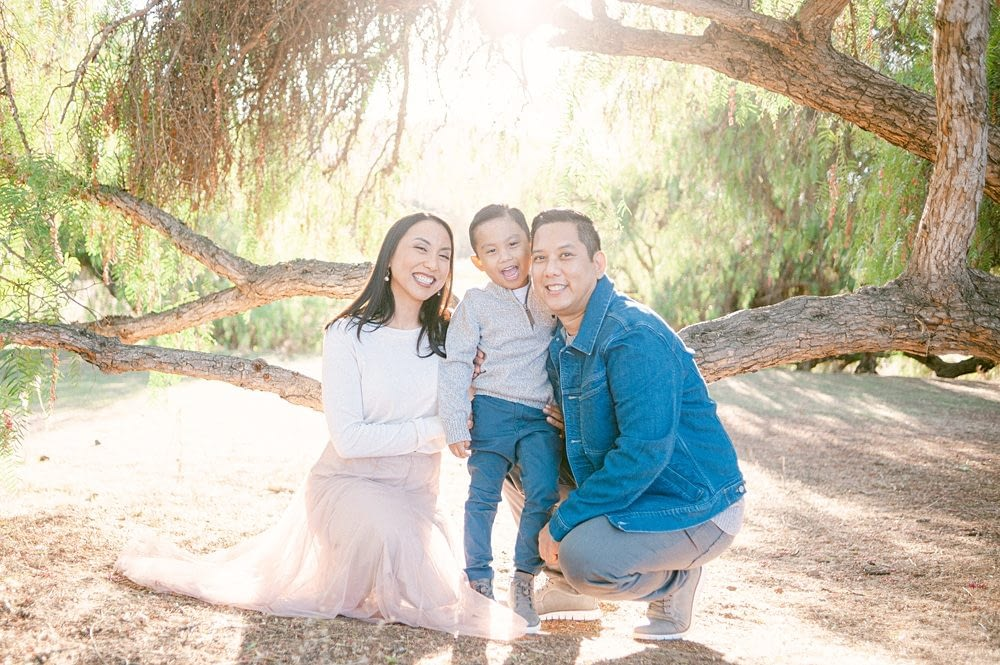 Beautiful Family under a tree in Los Penasquitos Preserve taken by Amy Huang Photography
